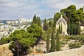 Christian chapel in the garden of cypress trees. Mount of Olives in East Jerusalem, Israel