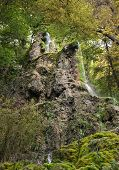 stock photo of swabian  - One cascade of the Gueterstein waterfall near Bad Urach in the Swabian Alps - JPG