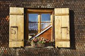 Exterior detail of the traditional Swiss chalet in Rougemont, Switzerland.