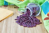 Dark Red Beans In A Glass Jar