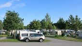 image of caravan  - Many caravans on a camping site, between the trees.
