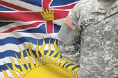 American Soldier With Canadian Province Flag On Background - British Columbia