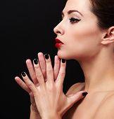 Sexy Makeup Profile Woman Face With Black Nails Posing. Closeup