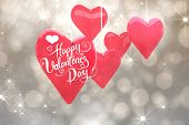 Happy valentines day against shimmering light design on grey