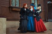 Three Girls In Retro Dresses.