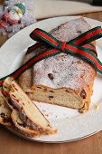 stock photo of cardamom  - Sliced Christmas stollen the traditional german fruit cake made of bread - JPG