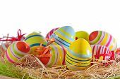 Colorful easter eggs isolated in basket