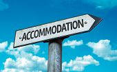 Accommodation sign with sky background