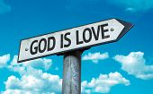 God is Love sign with sky background