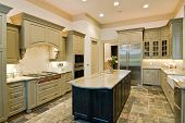 image of stone house  - luxury kitchen with new cabinets and slate floor - JPG