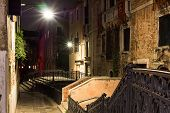 stock photo of old bridge  - Night street with bridges and old houses in Venice - JPG