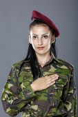 stock photo of army soldier  - Army soldier swear solemnly with hand on heart to defend country - JPG