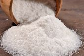 stock photo of salt mine  - Salt in a wooden bowl close up - JPG