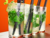 image of mojito  - Four Mojito cocktails shot on a bar counter - JPG