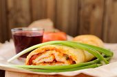 foto of scallion  - Pizza stromboli cut with glass of red wine fresh scallion and tomato selective focus copyspace horizontal - JPG
