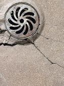stock photo of manhole  - Spiral manhole in a yard - JPG
