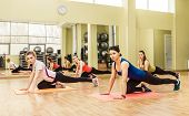 foto of step aerobics  - Group of women making step aerobics in the fitness class - JPG