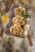 foto of scallops  - Presentation of scallops au gratin baked with parsley - JPG