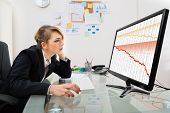 stock photo of collapse  - Young Businesswoman Watching Finance Collapse Graph On Computer Monitor - JPG