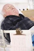 pic of hospital gown  - Senior man in hospital bed - JPG