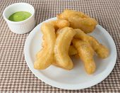 image of dessert plate  - Snack and Dessert Chinese Traditional Snacks Deep Fried Doughstick on A White Plate Served with Pandan Custard Dip - JPG