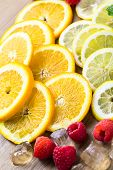 foto of infusion  - Sliced fresh organic fruits prepared to make infused water - JPG
