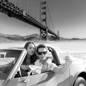 picture of golden gate bridge  - selfie of young teen couple at convertible car in San Francisco Golden Gate Bridge photo mount - JPG