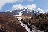 stock photo of mount fuji  - View of Mount Fuji with snow on summit - JPG