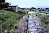 stock photo of dead-line  - level crossing house in abandoned rail line with midnight effect - JPG