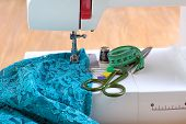picture of sewing  - Sewing machine and sewing accessories on wooden table - JPG