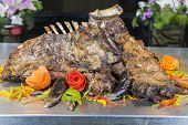 picture of lamb chops  - Closeup detail of lamb chops on display at a hotel restaurant carvery - JPG