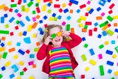stock photo of child development  - Child playing with colorful toys - JPG