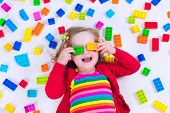 image of girl toy  - Child playing with colorful toys - JPG