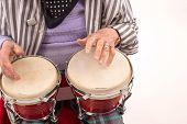 foto of bongo  - Funny elderly lady makes music with a wooden bongo - JPG