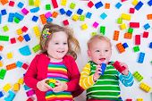 image of twin baby girls  - Child playing with colorful toys - JPG
