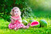 image of healthy eating girl  - Child eating watermelon in the garden - JPG