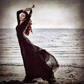Beautiful Goth Girl Standing On Sea Coast. Grunge Texture Effect poster