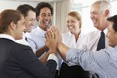 picture of seminar  - Group Of Businesspeople Joining Hands In Circle At Company Seminar - JPG