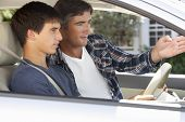 stock photo of driving  - Father Teaching Teenage Son To Drive - JPG
