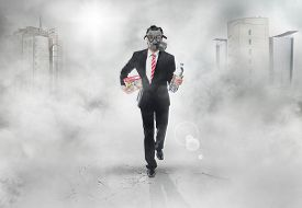 image of doomsday  - Business man with gas mask running survival concept - JPG