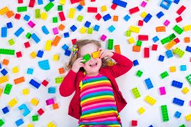foto of child development  - Child playing with colorful toys - JPG