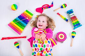 stock photo of daycare  - Child with music instruments - JPG