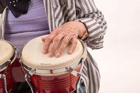 picture of bongo  - Funny elderly lady makes music with a wooden bongo - JPG