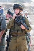 Israeli Soldier With Tear Gas Gun