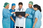 Team Of Doctors Search On Laptop