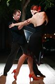 pic of tango  - Couple dancing tango dance on night street.