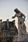 Louvre and woman statue
