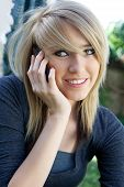 Smiling Teenager On Mobile Cell Phone