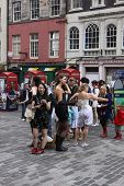 EDINBURGH- AUGUST 6: Performers for Five Clever Courtesans on Royal Mile during Edinburgh Fringe Fes