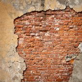 stock photo of wall-stone  - Old weathered brick wall fragment - JPG